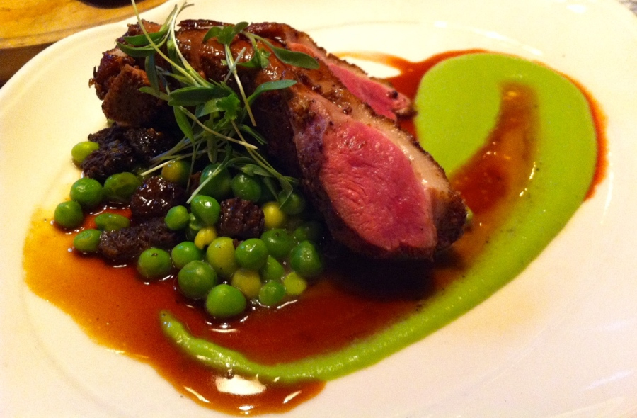 Duck breast with morel mushrooms and English peas at The Standard Grill, NYC.