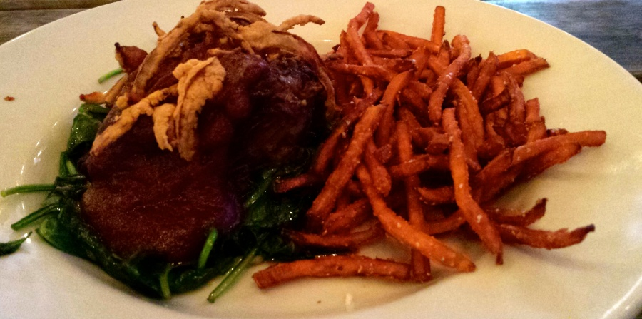 Beef short rib topped with pomegranate barbeque sauce and crispy fried onions, over a bed of sauteed spinach and sweet potato fries.